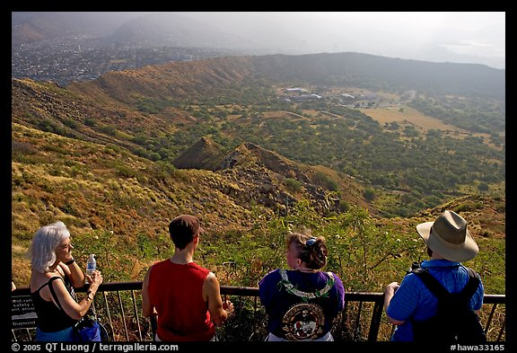 Tourists look at the  Diamond Head crater, early morning. Oahu island, Hawaii, USA
