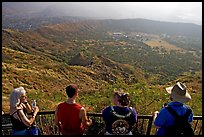 Tourists look at the  Diamond Head crater, early morning. Oahu island, Hawaii, USA (color)