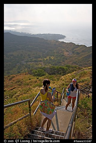 Tourists take a photo on the last steps of the Diamond Head crater summit trail. Oahu island, Hawaii, USA