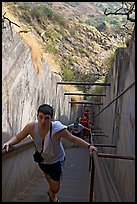Tourist climbing a staircase on the Diamond Head summit trail. Oahu island, Hawaii, USA (color)
