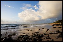 Boulders, beach and clouds, Lydgate Park, sunrise. Kauai island, Hawaii, USA