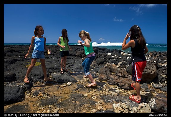 Girls playing in tidepool, Kukuila. Kauai island, Hawaii, USA (color)