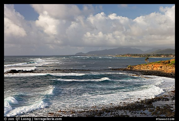Coastline north of Kapaa with Sleeping Giant profile, early morning. Kauai island, Hawaii, USA (color)