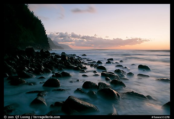 Boulders, surf, and Na Pali Coast, Kee Beach, dusk. Kauai island, Hawaii, USA (color)