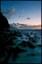 Boulders and misty surf from Kee Beach, dusk. Kauai island, Hawaii, USA