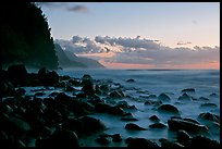 Boulders, surf, and Na Pali Coast, Kee Beach, dusk. Kauai island, Hawaii, USA