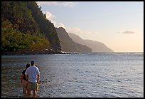 Couple standing in water, Kee Beach, late afternoon. Kauai island, Hawaii, USA (color)