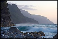 Boulders, waves, and Na Pali Coast, sunset. North shore, Kauai island, Hawaii, USA ( color)