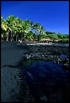 Beach of basalt black sand  at Punaluu. Big Island, Hawaii, USA