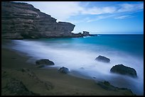 Blurred waves and cliff, Papakolea Beach. Big Island, Hawaii, USA