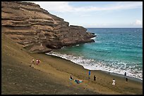 People on Mahana (green sand) Beach. Big Island, Hawaii, USA