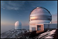 Recent snow and telescopes at sunset. Mauna Kea, Big Island, Hawaii, USA