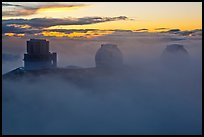 Telescopes, clouds, and fog at sunset. Mauna Kea, Big Island, Hawaii, USA