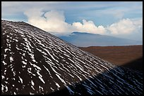 Cinder cone with snow stripes, distant clouds. Mauna Kea, Big Island, Hawaii, USA (color)