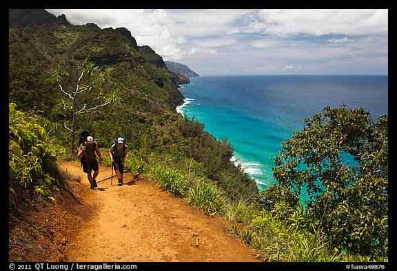 Hikers on Kalalau trail, Na Pali coast. Kauai island, Hawaii, USA (color)