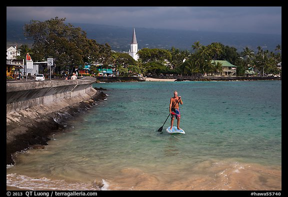 Paddlesurfer and Kailua-Kona. Hawaii, USA (color)