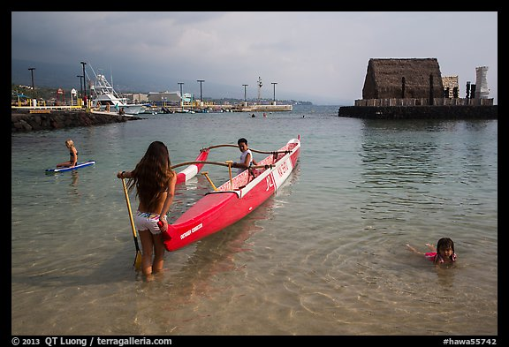 Girls, outrigger canoe, and Kamakahonu heiau, Kailua-Kona. Hawaii, USA (color)