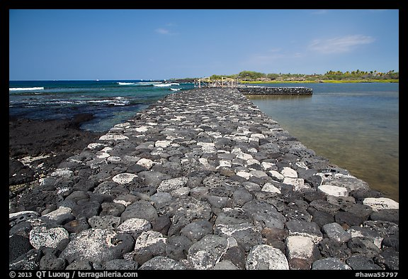 Rock wall separating Kaloko fishpond from the ocean, Kaloko-Honokohau National Historical Park. Hawaii, USA (color)