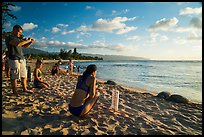 Visitors view sea turtles on Laniakea Beach. Oahu island, Hawaii, USA ( color)