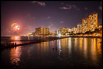 Watching fireworks from seawall, Kuhio Beach, Waikiki. Waikiki, Honolulu, Oahu island, Hawaii, USA ( color)
