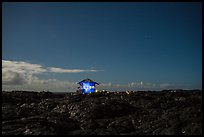 Illuminated house on the lava field, Kalapana. Big Island, Hawaii, USA ( color)