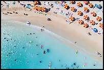Aerial view of sun umbrellas and beachgoers looking down, Kuhio Beach. Waikiki, Honolulu, Oahu island, Hawaii, USA ( color)