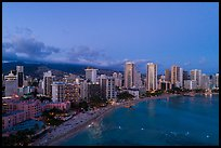 Aerial view of Waikiki Beach and skyline at dusk. Honolulu, Oahu island, Hawaii, USA ( color)