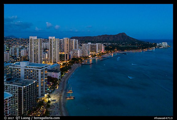 Aerial view of Waikiki Beach, skyline, and Diamond Head at night. Honolulu, Oahu island, Hawaii, USA (color)