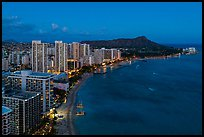 Aerial view of Waikiki Beach, skyline, and Diamond Head at night. Honolulu, Oahu island, Hawaii, USA ( color)