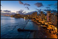 Aerial view of Kuhio Beach, skyline at dusk. Honolulu, Oahu island, Hawaii, USA ( color)