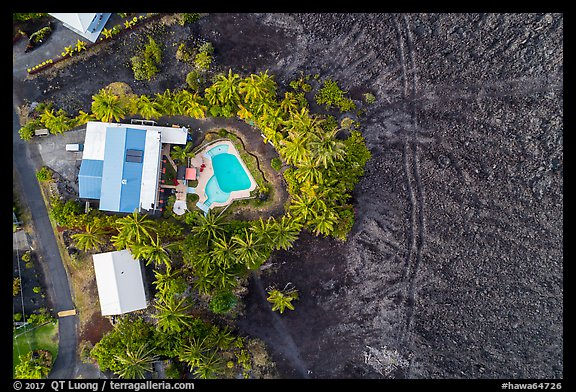 Aerial view of house and pool on edge of lava field. Big Island, Hawaii, USA (color)