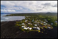 Aerial view of residential community on edge of lava field. Big Island, Hawaii, USA ( color)
