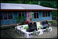 Tombs in front of a home in Faleasao. American Samoa (color)
