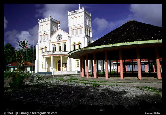 Church and fale in Leone. Tutuila, American Samoa (color)