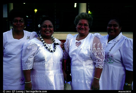 Sunday women churchgoers dressed in white, Pago Pago. Pago Pago, Tutuila, American Samoa (color)