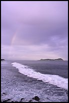 Rainbow at sunset, wave, and Aunuu island. Aunuu Island, American Samoa ( color)