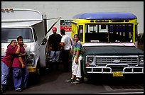 People and colorful buses. Pago Pago, Tutuila, American Samoa ( color)