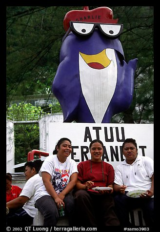 Women in front of statue of Charlie the Tuna. Pago Pago, Tutuila, American Samoa (color)