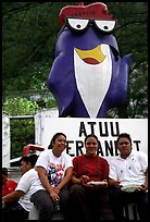 Women in front of statue of Charlie the Tuna. Pago Pago, Tutuila, American Samoa ( color)