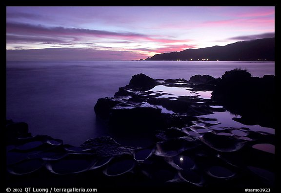 Grinding stones holes (foaga) filled with water at dusk, Leone Bay. Tutuila, American Samoa (color)