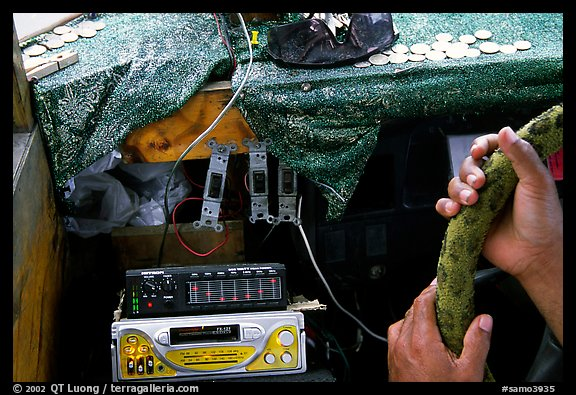 Hands of Aiga bus driver and sound system. Pago Pago, Tutuila, American Samoa (color)