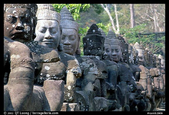 Statues near the gates of the temple complex. Angkor, Cambodia (color)