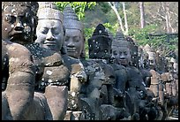 Statues near the gates of the temple complex. Angkor, Cambodia