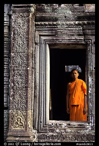 Buddhist monk in doorway, the Bayon. Angkor, Cambodia (color)