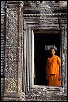 Buddhist monk in doorway, the Bayon. Angkor, Cambodia