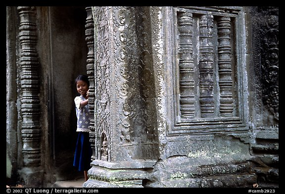 Girl hides in Ta Prom. Angkor, Cambodia (color)