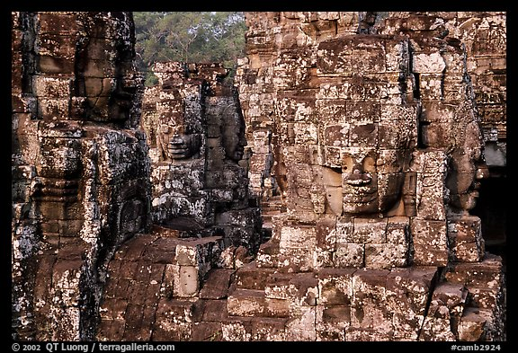 Large stone smiling faces on upper terrace, the Bayon. Angkor, Cambodia (color)