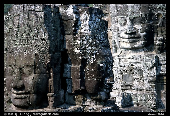 Large stone faces occupying towers, the Bayon. Angkor, Cambodia (color)
