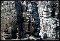 Large stone faces occupying towers, the Bayon. Angkor, Cambodia