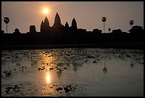 Angkor Wat reflected in pond at sunrise. Angkor, Cambodia (color)